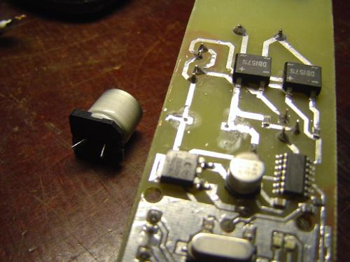 SMD capacitor turned though-hole
