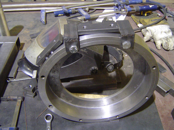 Lower bearing mount, with string connection plates being welded to its side